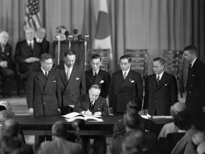 Original caption: Second Treaty For the Japanese. San Francisco, California: Shigeru Yoshida, Prime Minister of Japan, signs the Bilateral Security Treaty with the United States in the San Francisco Presidio. The Security Treaty, which was signed shortly after the signing of the Japanese Peace Treaty, permits American land, sea and air forces to remain in and around Japan after the Peace Treaty becomes effective. September 8, 1951. September 8, 1951 San Francisco, California, USA